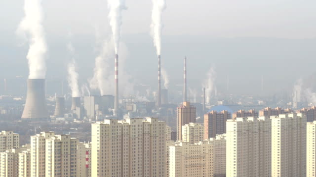 vídeos de stock e filmes b-roll de aerial view of steel mill and air pollution in lanzhou, china - chaminé de fábrica