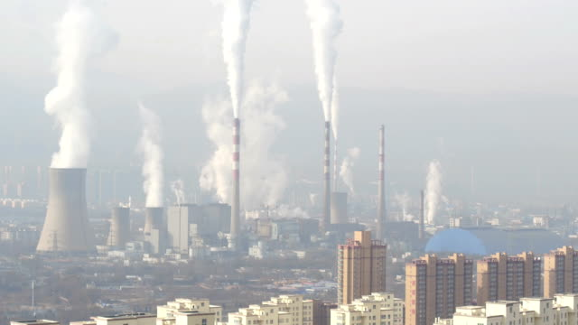 aerial view of steel mill and air pollution in lanzhou, china - smog video stock e b–roll