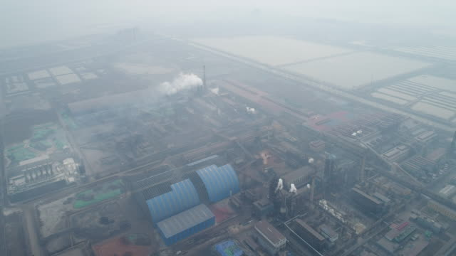 Aerial view of steel mills air pollution on March 10 2017 in Tangshan China Beijing is surrounded by steelworks in Hebei province and most of them...