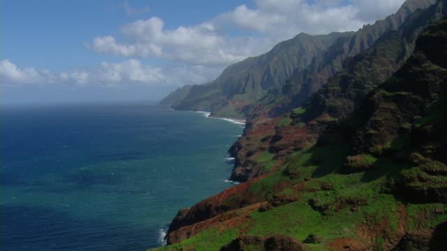 aerial view of steep coastal cliffs near nualolo kai state park on the hawaiian island of kauai. - big island hawaii islands stock videos and b-roll footage
