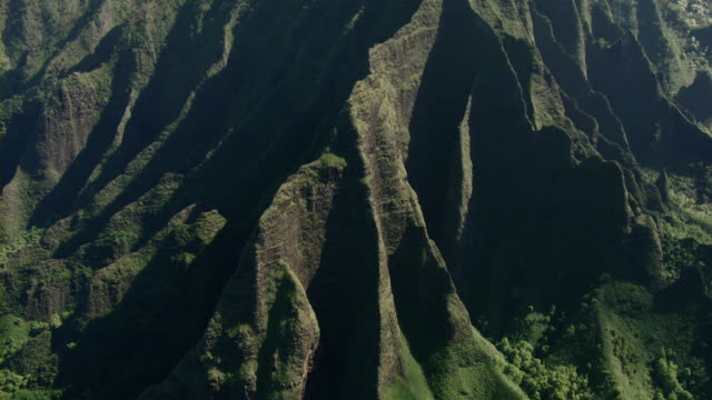aerial view of steep rock formations in na pali coast state park on the hawaiian island of kauai. - na pali coast state park stock videos & royalty-free footage