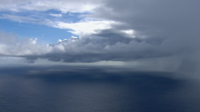 Aerial view of storm clouds over the Pacific Ocean and the East Coast of Molokai, Hawaii near Wailau Valley.