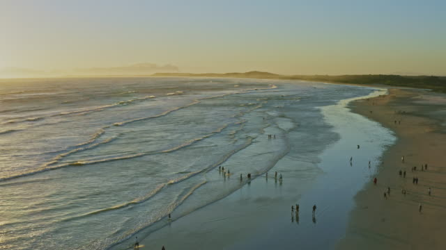 aerial view of strand beach in western cape at sunset, south africa - strand south africa stock videos & royalty-free footage