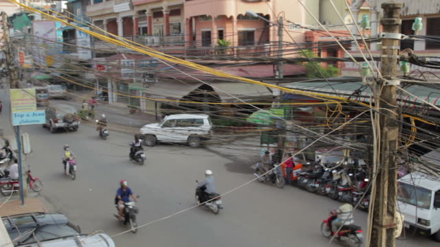 aerial view of street and messy wiring on a utility pole in phnom penh, cambodia - phnom penh stock videos and b-roll footage