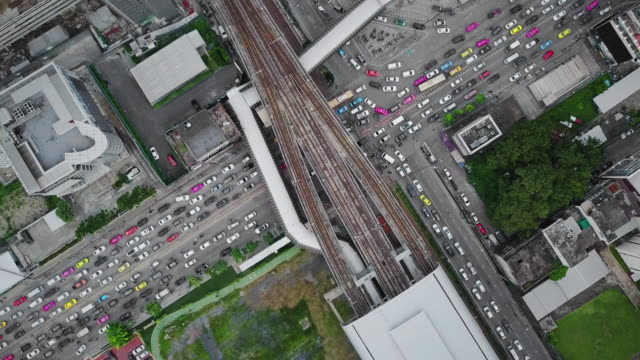 Aerial View of Street Intersection and bridge link between mrt and bts mass transportation in Bangkok,Thailand