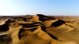 Aerial view of strong shadows created by desert landscape, U.A.E.