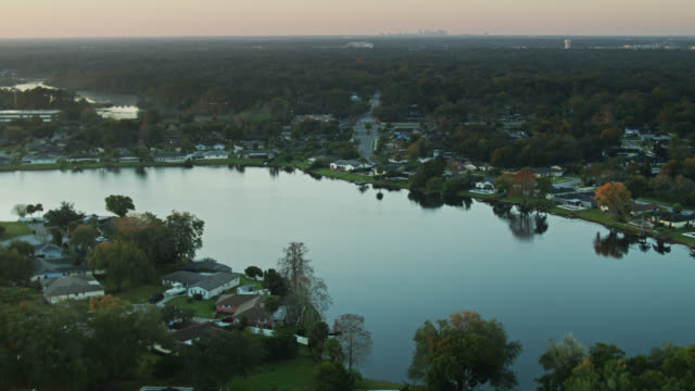 aerial view of suburb near orlando at sunrise - lakeshore stock videos & royalty-free footage