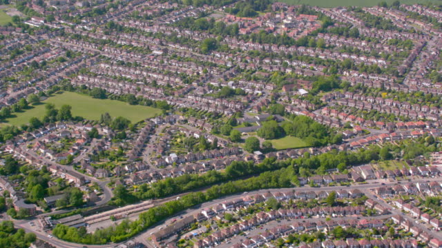 aerial view of suburban houses in london, uk. 4k - council flat stock videos & royalty-free footage