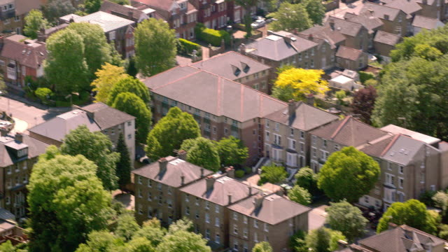 aerial view of suburban houses in london, uk. 4k - suburban stock videos & royalty-free footage