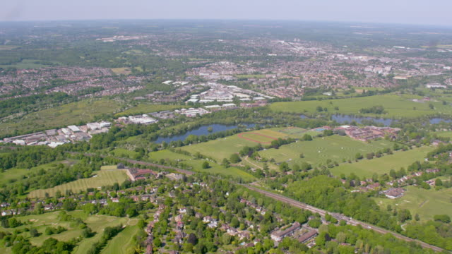 aerial view of suburban towns west of london, uk. 4k - housing development stock videos & royalty-free footage