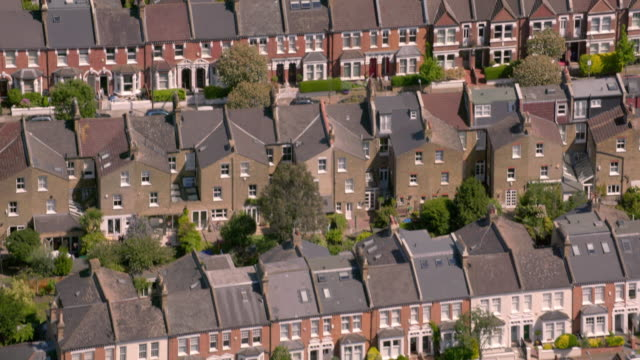 aerial view of suburban victorian houses in london, uk. 4k - roof stock videos & royalty-free footage