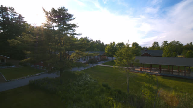 aerial view of summer camp on a sunny day with children running around - landscaped stock videos & royalty-free footage