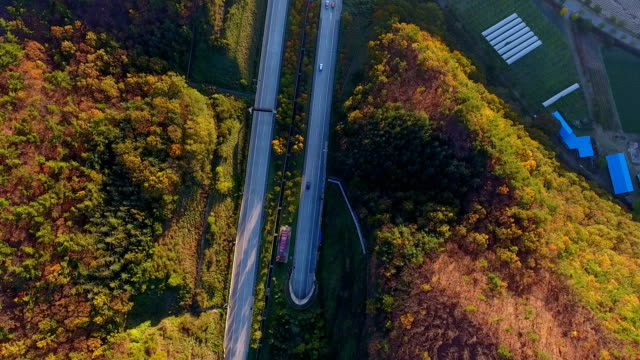 aerial view of sun rising at suritijae mountain range (famous mountain range in korea) in autumn - on the move stock videos & royalty-free footage
