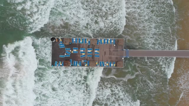 Aerial View of Sunbeds on a Wharf in a Beach during Stormy Weather