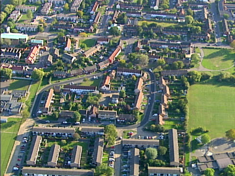 Aerial view of sunny suburbia (two shots). NTSC, PAL