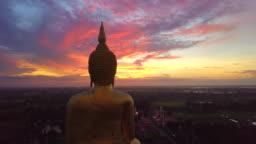 Aerial view of Sunrise at Big buddha Wat Muang landmark of Ang Thong Province, Thailand
