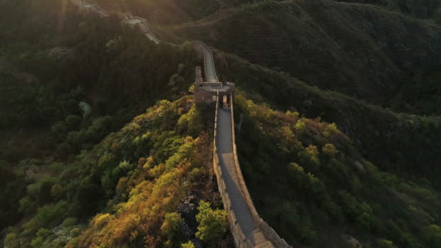 aerial view of sunrise of the great wall - castle wall stock videos and b-roll footage