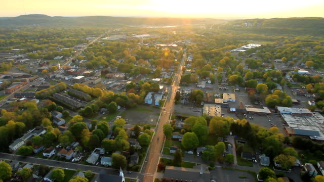 Aerial view of sunrise over suburban landscape