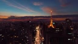 Aerial view of sunset on Paulista Avenue, São Paulo, Brazil. Dusk's scenery. Downtown's scene.  Landmark of the city, Heart of São Paulo. Colored sky.