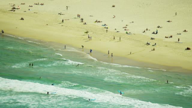 stockvideo's en b-roll-footage met aerial view of surfers at bondi beach sydney - zuidelijk halfrond