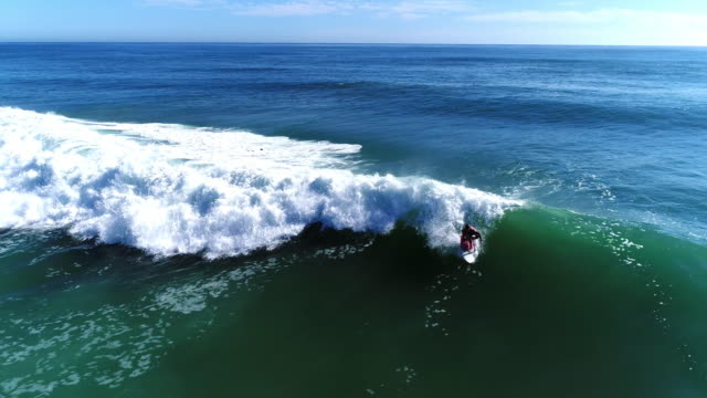 Aerial view of surfers riding the waves