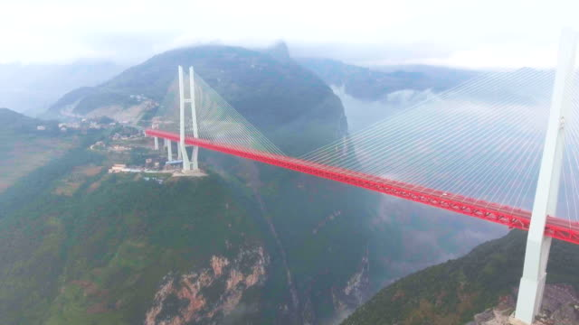 aerial view of suspension bridge connect between the mountain, ghuizhou, china - canyon stock videos & royalty-free footage