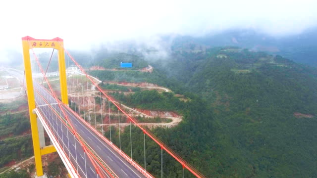 aerial view of suspension bridge connect between the mountain, ghuizhou, china - high up stock videos & royalty-free footage