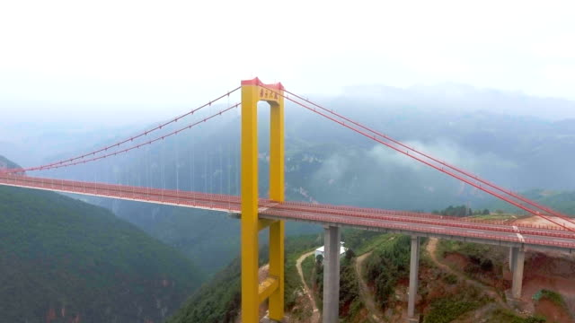 aerial view of suspension bridge connect between the mountain, ghuizhou, china - suspension bridge stock videos & royalty-free footage