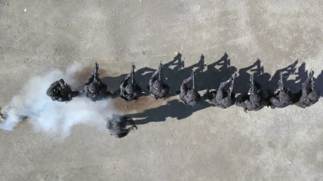 aerial view of swat police officers shooting with firearm - ufficiale grado delle forze armate video stock e b–roll