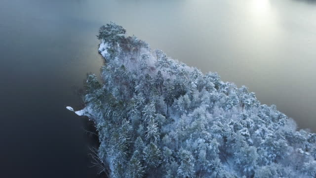 aerial view of swedish lake in winter - island stock videos & royalty-free footage
