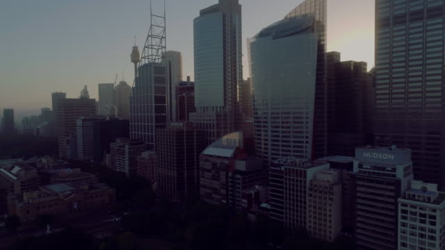 aerial view of sydney city skyline backlit by the sun. sydney australia - tower stock videos & royalty-free footage