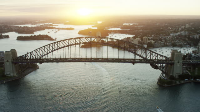 aerial view of sydney harbor bridge at sunset - ferry stock videos & royalty-free footage