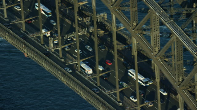 aerial view of sydney harbor bridge climb sunset - sydney stock videos & royalty-free footage