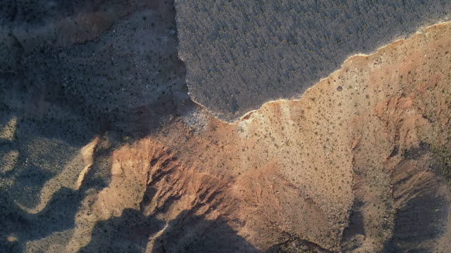 aerial view of table mountains in a highland nearby mesquite, nevada, usa, in the early springtime. top view directly above photo.  drone 4k uhd video with the panning camera motion. - nevada stock videos & royalty-free footage
