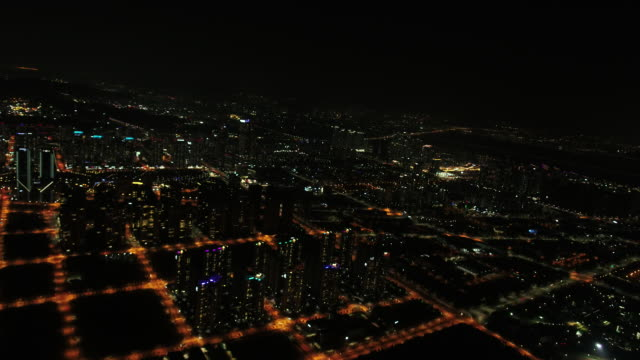 stockvideo's en b-roll-footage met aerial view of tall buildings at night on songdo area in incheon - incheon