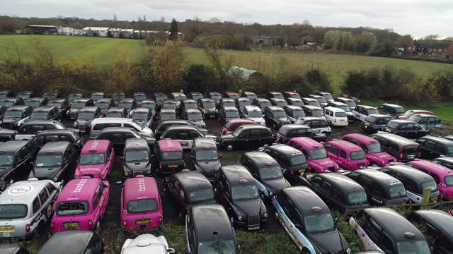 aerial view of taxis stored in epping forest amid covid-19 lockdown. black cabs stored in epping forest field after coronavirus lockdown forces them... - taxi stock videos & royalty-free footage