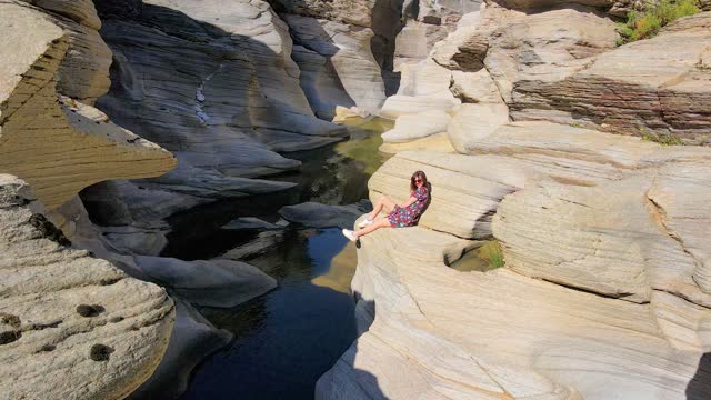 aerial view of taşyaran valley and canyon, water flowing through the valley, interesting looking valley or canyon, symbol of turkey, most different places, beautiful woman sitting against the view, beautiful woman traveling - take that stock videos & royalty-free footage
