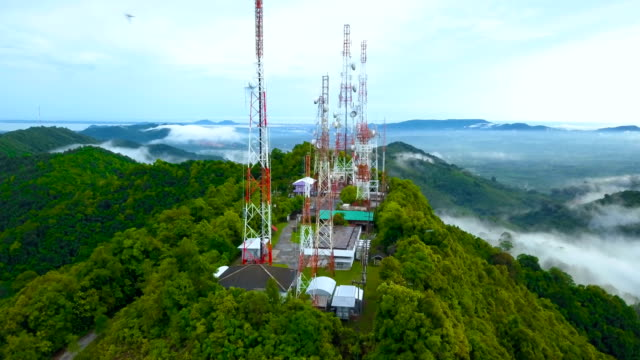 aerial view of telecommunication antenna in the forest - tower stock videos & royalty-free footage