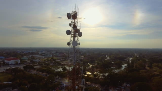 aerial view of telecommunication over city - antenna aerial stock videos & royalty-free footage