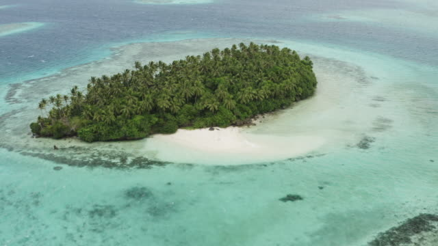 Aerial view of tent and kayak on an uninhabited island