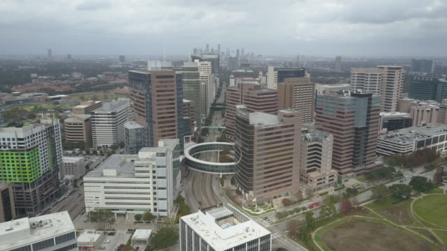 aerial view of texas medical center in houston, texas. - medical building stock videos & royalty-free footage