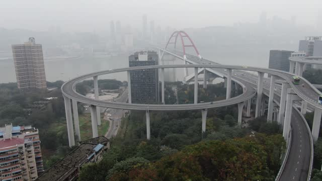 aerial view of the 72-meter-high sujiaba flyover looks like a roller coaster is seen on december 10, 2020 in chongqing, china. - road junction stock videos & royalty-free footage