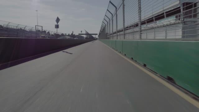 aerial view of the albert park motor race track, pit lane. melbourne australia - sportstrecke stock-videos und b-roll-filmmaterial