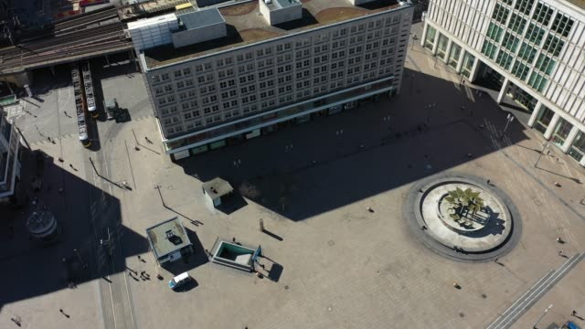 aerial view of the alexanderplatz standing nearly empty following the tightening of measures affecting public life due to the coronavirus on march 22... - アレクサンダープラッツ点の映像素材/bロール