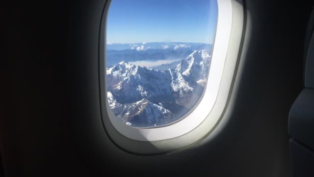 Aerial view of the Andes Alps from window airplane