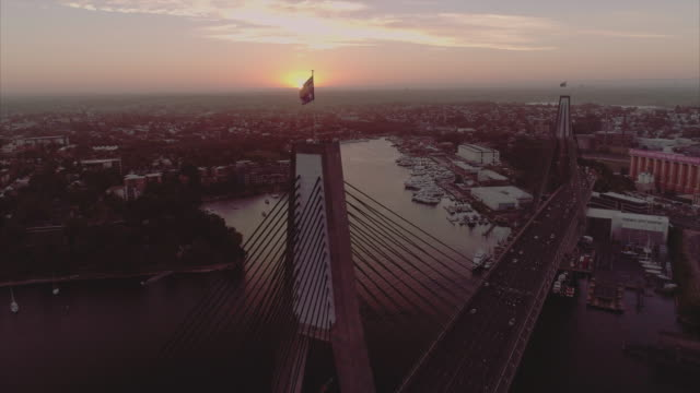 aerial view of the anzac bridge flag tilting down. sydney australia - viewpoint stock videos & royalty-free footage