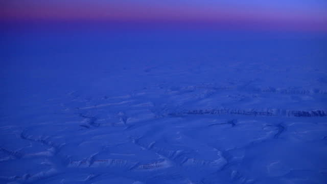 aerial view of the arctic landscape at dusk - ice sheet stock videos and b-roll footage