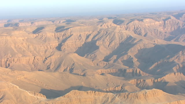 aerial view of the arid hills west of deir el bahari and the temple of hatshepsut. - tempio di hatshepsut video stock e b–roll