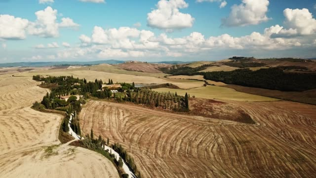 aerial view of the arid tuscany hills - masseria video stock e b–roll