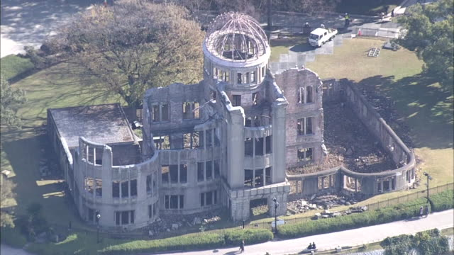 aerial view of the atomic bomb dome: zooming out: wide angle view of the cityscape of hiroshima: hiroshima peace memorial park seen on the other side... - other stock videos & royalty-free footage